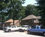Brick home with new roof by Roofing Systems of Hampton Roads