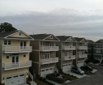 Beach Townhouses with new roofs by J.Montes, Inc.